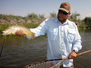 Crane Meadow Lodge guide Dave King with a nice Beaverhead brown caught and released on a hopper