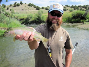 Crane Meadow Lodge guide Tom Caffrey with a Ruby River cutthroat caught and released on a hopper