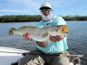Patrice Camillieri, from France, caught and released this big trout on a Grassett Flats Minnow fly while fishing the coastal gulf with Capt. Rick Grassett in December.