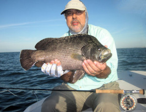 Patrice Camillieri, from France, caught and released this big tripletail on a Grassett Flats Minnow fly while fishing the coastal gulf with Capt. Rick Grassett in December.