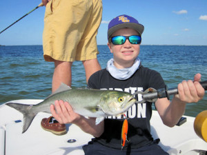 Tommy Lewis, from NC, caught and released this Sarasota Bay bluefish on a top water plug while fishing deep grass flats with Capt. Rick Grassett.